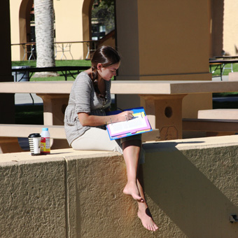 Student outside reading